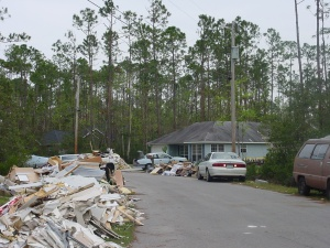 Katrina 8 – Another picture of our neighborhood. It would make an interesting reality show: Dodge the Debris.