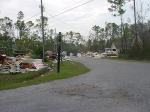Katrina 7 – Another view down one of our streets. Everyone who was flooded had to put their ruined furniture, belongings, sheetrock and insulation somewhere. It makes driving around the neighborhood quite a challenge, because the debris starts spilling over into the streets.